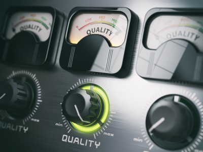"""dashboard of car with the work """"Quality"""" highlighted."""