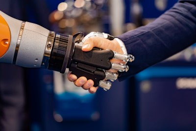 robot and person shaking hands