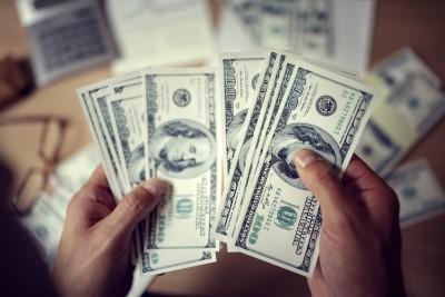 person holding hundred dollar bills