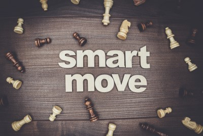 """image with chess pieces that says """"Smart Move"""""""