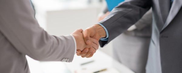 A physical handshake is still a powerful gesture.