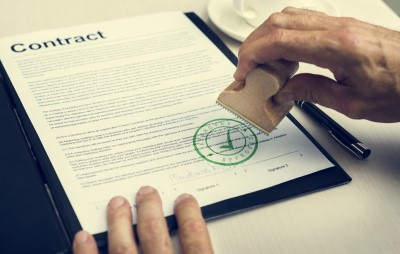 A contract getting an approval stamp. Don't work on anything that the client has not officially approved of on either a signed contract or scope of work.